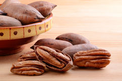 Pecan nuts in bowl Stock Photo