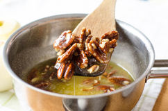 Pecan nuts and butter. A mixture of pecan nuts and butter with sugar for making pecan nuts tart Stock Images