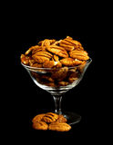 Pecan Nuts in crystal serving bowl. On black background Royalty Free Stock Images