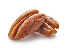 Pecan nuts macro. Isolated on white background, selective focus Royalty Free Stock Photo