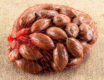 Pecan nuts in net Royalty Free Stock Photos