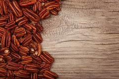 Pecan nuts on old wooden background Royalty Free Stock Photography