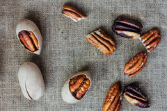 Pecan nuts on piece of cloth over wooden table. Royalty Free Stock Photo