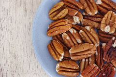 Pecan nuts in a plate Royalty Free Stock Images