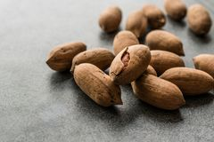 Pecan Nuts with Shell in Wooden Bowl / Walnuts stock photos