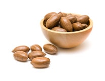 Pecan nuts in small wooden bowl Stock Photo