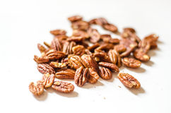 Pecan nuts. On a white background royalty free stock photo