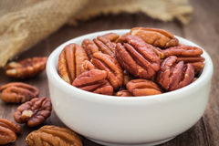Pecan nuts in white bowl Royalty Free Stock Images
