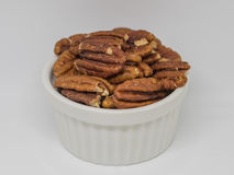 Pecan nuts  in the white cup Stock Images