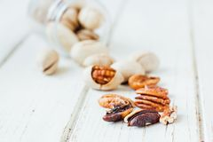 Pecan nuts on white Stock Images