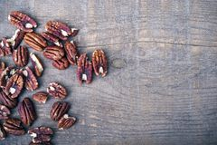 Pecan Nuts on Wood. Raw Fresh Pecan Nuts on Aged Wood. Top View Royalty Free Stock Images