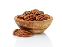 Pecan nuts in wood bowl Stock Images