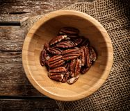 Pecan nuts on wooden background Royalty Free Stock Photography