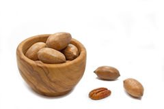 Pecan nuts in a wooden bowl Stock Image