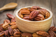 Pecan nuts in wooden bowl Royalty Free Stock Photography