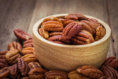 Pecan nuts in wooden bowl Royalty Free Stock Image