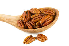 Pecan nuts in a wooden spoon Royalty Free Stock Image