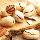 Pecan nuts on wooden table Stock Images