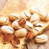 Pecan nuts on wooden table Royalty Free Stock Photography