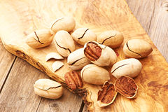Pecan nuts on wooden table Royalty Free Stock Image