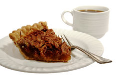 Pecan Pie. With a golden brown crust with a cup of coffee isolated on white Royalty Free Stock Image