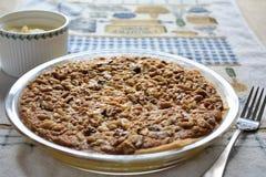 Pecan pie. A pecan pie with cream stock photo