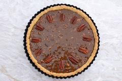 Pecan pie decorated with nuts ready to be baked Stock Image