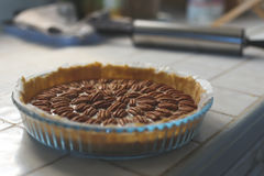 Pecan Pie. Homemade pecan pie sitting on a kitchen counter Royalty Free Stock Photography