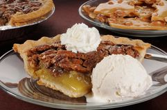 Pecan pie with ice cream Royalty Free Stock Photography