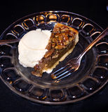 Pecan pie and ice cream on a plate Royalty Free Stock Image