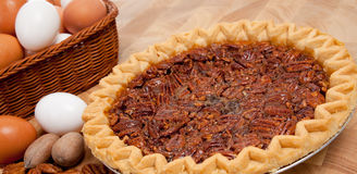 Pecan pie with ingredients on a cutting board Royalty Free Stock Photography