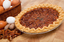 Pecan pie with ingredients on a cutting board Royalty Free Stock Photo