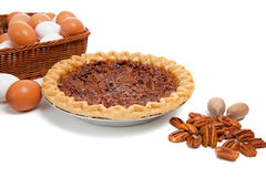 Pecan pie with ingredients on a white background Stock Image