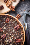 Pecan pie, nut crusher on table Royalty Free Stock Images