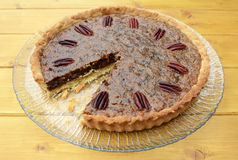 Pecan pie on a plate with one slice taken Royalty Free Stock Photo