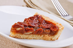 Pecan pie slice Stock Images