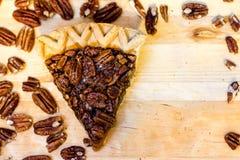 Pecan Pie Slice and Pecans. With copy space Stock Photos