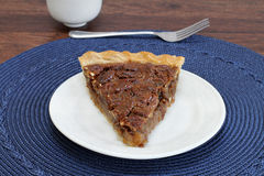 Pecan pie slice, point forward, close up. Royalty Free Stock Images