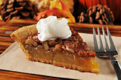 Pecan pie with whipped cream Stock Photos