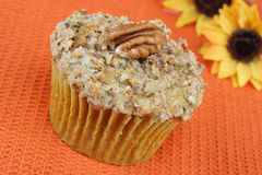 Pecan Pumpkin Muffin with streusel topping. Royalty Free Stock Photo