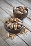Pecan. Raw pecans in wooden bowls. Selective focus Stock Photography