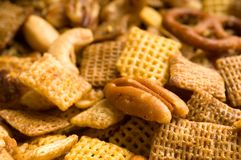 Pecan Snack Mix Background. Close Up of cereal, pretzel, and nut snack mix background with limited DOF Stock Photos
