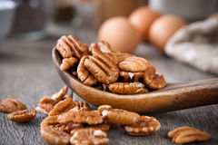 Pecans. In a wooden spoon Royalty Free Stock Photography