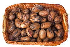 Pecans. In a wicker basket stock images