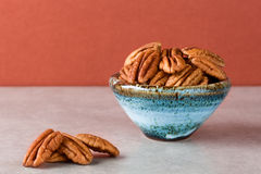 Pecans in ceramic bowl with copy space Stock Photography