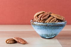 Pecans in ceramic bowl with copy space Royalty Free Stock Image