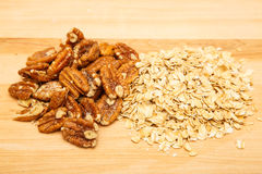 Pecans and Oats on Wood Board Stock Photography