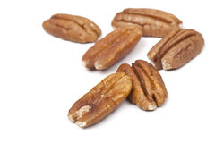 Pecans Over White. Fresh pecans, isolated on white background with soft shadow Royalty Free Stock Photography