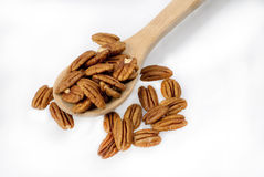 Pecans in a spoon Stock Photos