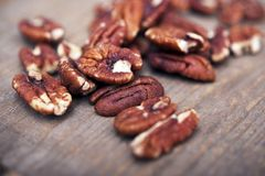 Pecans on VIntage Wood. Fresh Pecans on VIntage Wood Table Closeup Royalty Free Stock Photography